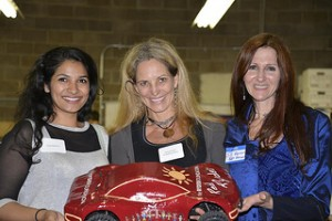 Salmah Nakuda, Maureen Block, and Jill Robinson with the Red Ryder Racer